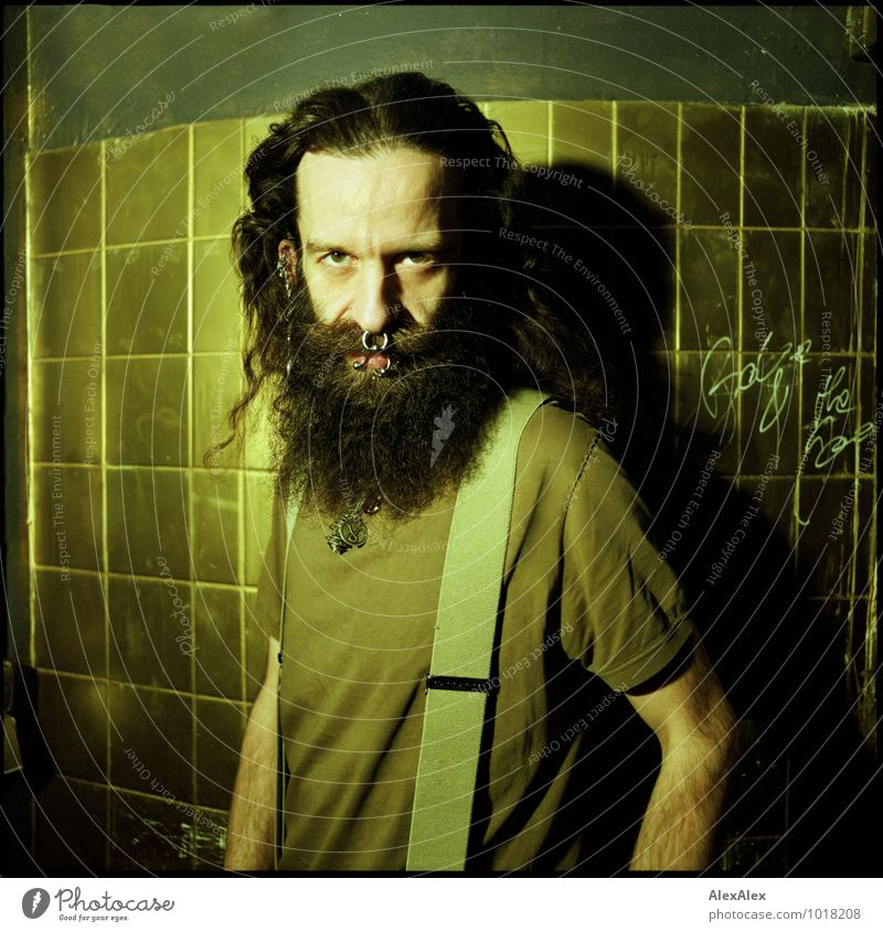 turn towards Room Man Adults Face 30 - 45 years T-shirt Suspenders Jewellery Piercing Black-haired Long-haired Beard Tile Gold Observe Communicate Esthetic
