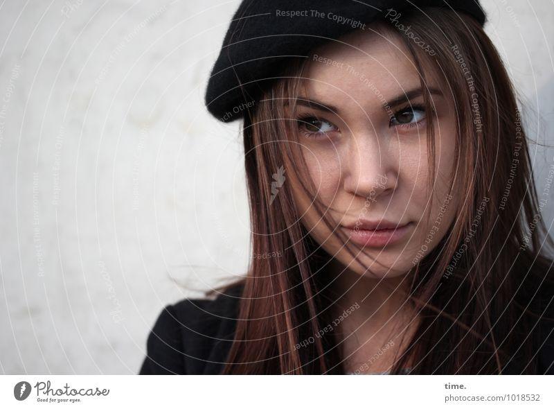 Yuliya Feminine Young woman Youth (Young adults) 1 Human being Wall (barrier) Wall (building) Jacket Hat Brunette Long-haired Observe Think Looking Wait
