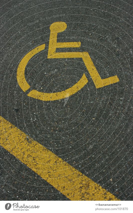 Wheelchair Downhill Yellow Gray Lettering Pictogram Logo Handicapped Parking lot Speed Action Exceptional Stripe Concrete Street sign Signs and labeling Signal