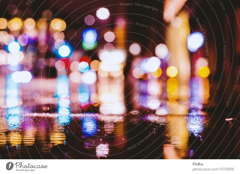 City lights in the gutter Earth Water Rain Town Lanes & trails Wet Violet Orange Black Paving stone Blur Damp Point of light Light (Natural Phenomenon) Puddle