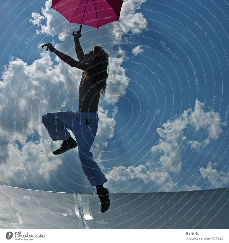 Young hopper Coincidence Man Young man Long-haired Blonde Thin Umbrella Patron Drought Pink White Jump Hop Gesture Clouds Heavenly Sky blue Summery Wind Gale
