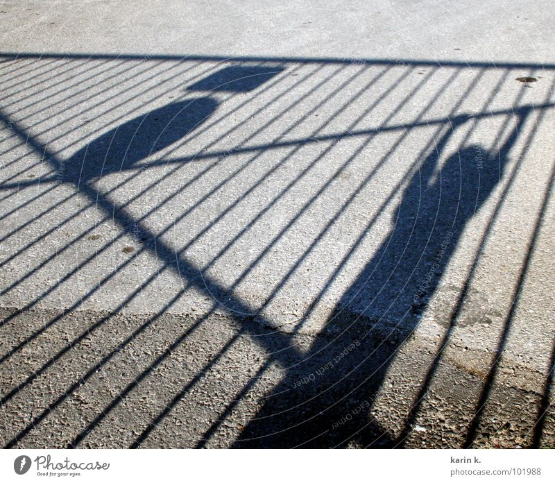 Child Relaxation Boy (child) Arm Asphalt Fence Hang Shadow play