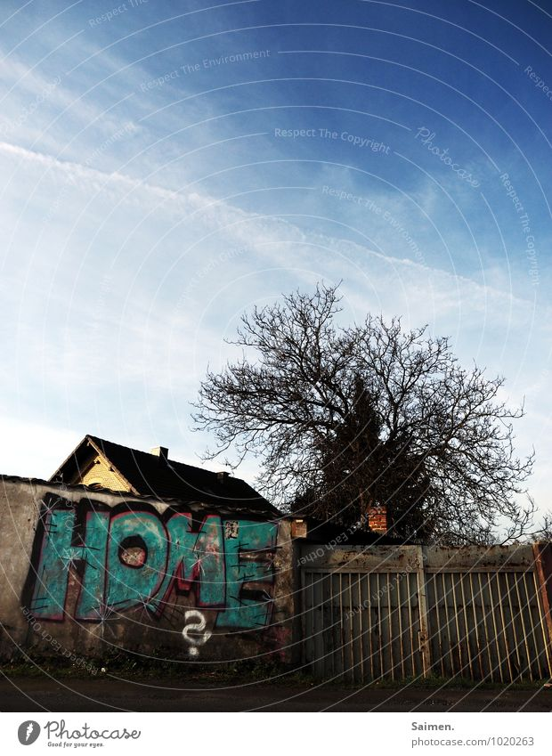 Home is where the graffiti is Sky Clouds Tree Town Outskirts House (Residential Structure) Detached house Wall (barrier) Wall (building) Identity Building Roof