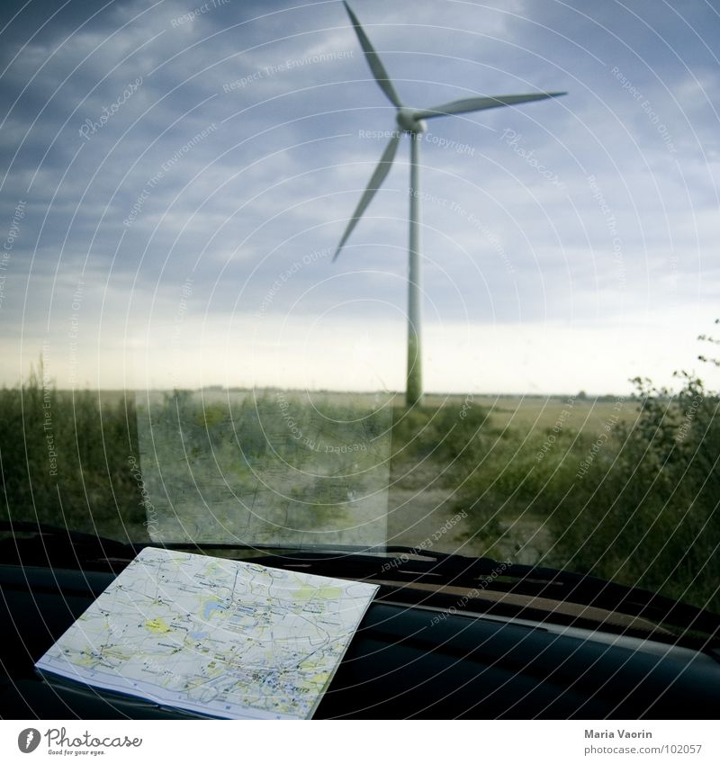 Honey, I think we're lost! Vacation & Travel Motoring Break Map Dark Clouds Bad weather Storm Propeller Wind energy plant Electricity Environment