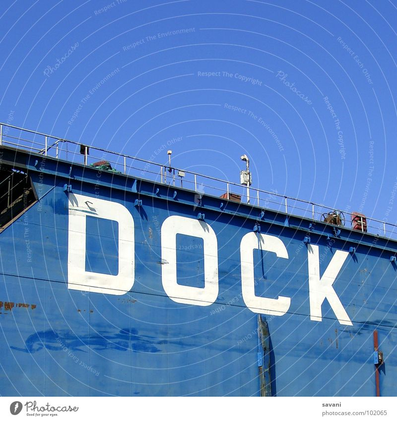 Dock in the port of Hamburg Summer Sky Beautiful weather River Harbour Wall (barrier) Wall (building) Watercraft Characters Blue White Letters (alphabet) Elbe