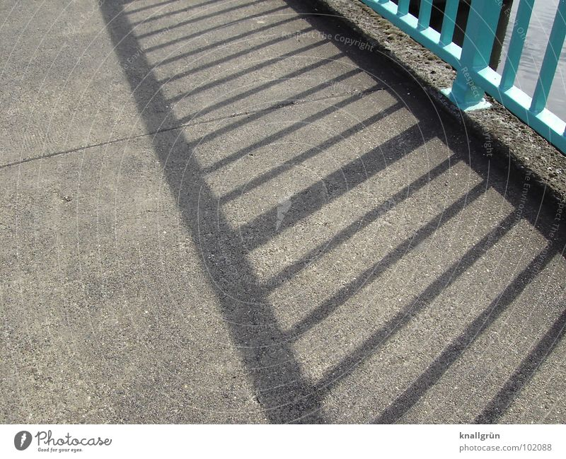 Where there is much light... Stripe Turquoise Light blue Asphalt Gray Bridge railing Summer's day Shadow Sun Lanes & trails To go for a walk