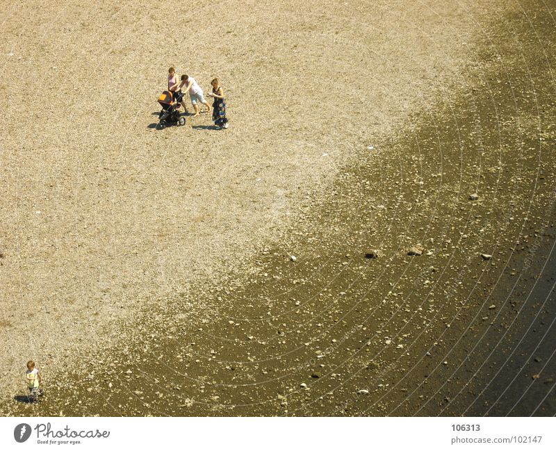 Human being Woman Child Man Water Ocean Beach Loneliness Calm Relaxation Playing Boy (child) Coast Sand Stone Lake