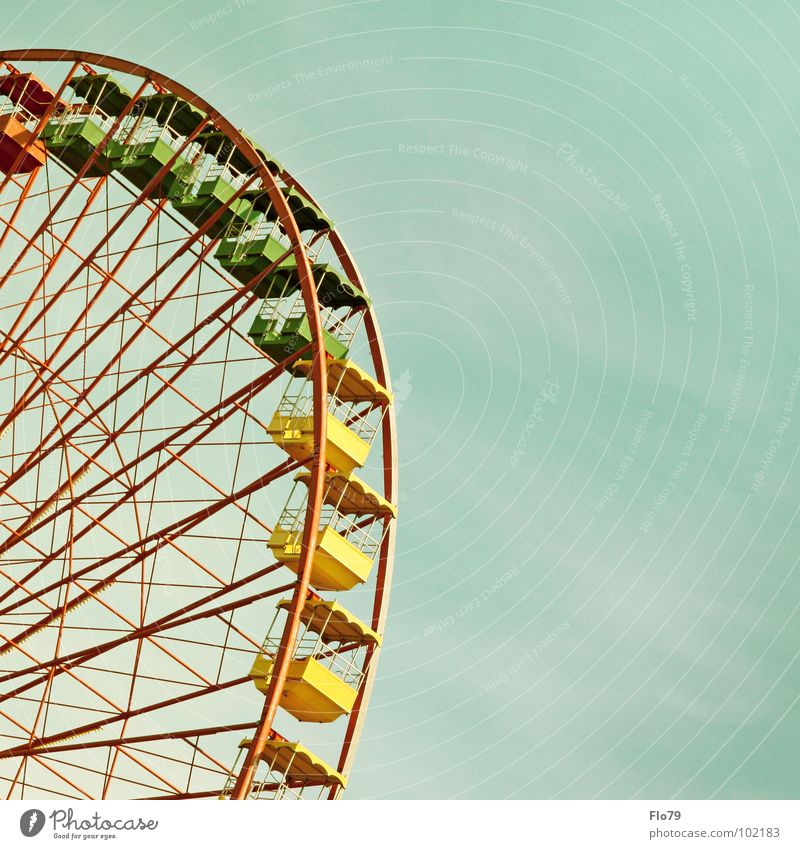 ostalgia Ferris wheel Fairs & Carnivals East Debts Shut down Yellow Green Red Multicoloured Steel Iron Aspire Vanishing point Large Might Rotate Circle