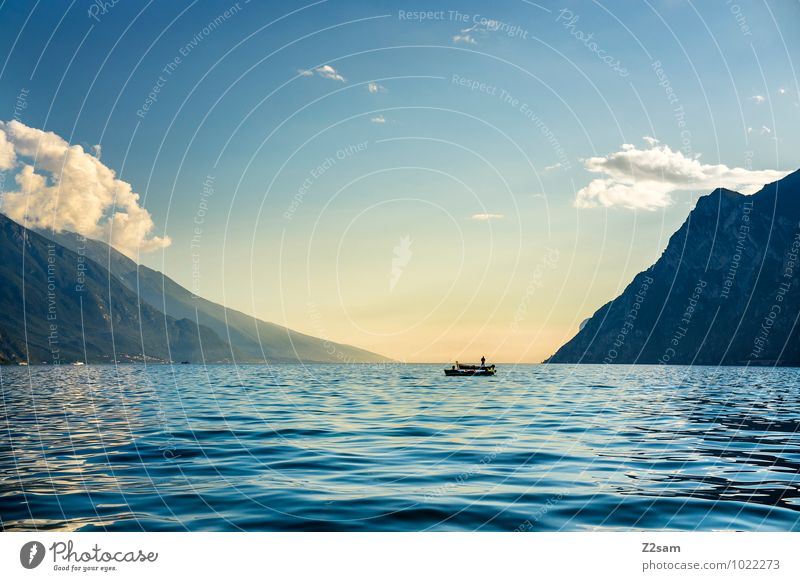 Human being Sky Nature Vacation & Travel Summer Sun Relaxation Landscape Calm Far-off places Adults Mountain Lake Watercraft Masculine Leisure and hobbies