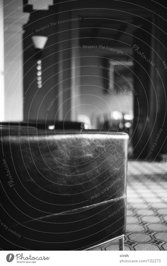 Launsch Hotel Armchair Leather chair Black Sofa Simple Lamp Furniture Blur Detail Black & white photo Old Modern tiled floor Foyer turn of the century Warehouse
