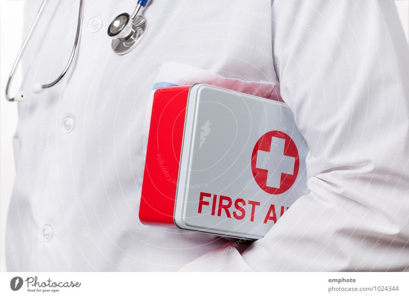 Doctor with first aid kit box under his arm Health care Tool Man Adults 1 Human being Coat Work and employment Carrying Red White consultant practitioner