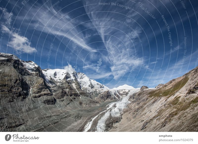 Landscape with high mountain peaks and melting glacier Beautiful Relaxation Summer Snow Mountain Environment Nature Sky Clouds Horizon Climate Climate change