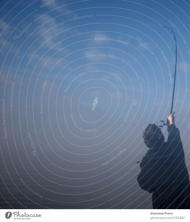 The fisherman Fog Morning Fishing rod Throw Fishing (Angle) Swing Clouds Sky Unclear Leisure and hobbies Ocean rod swing Blur Exterior shot Angler Only one man