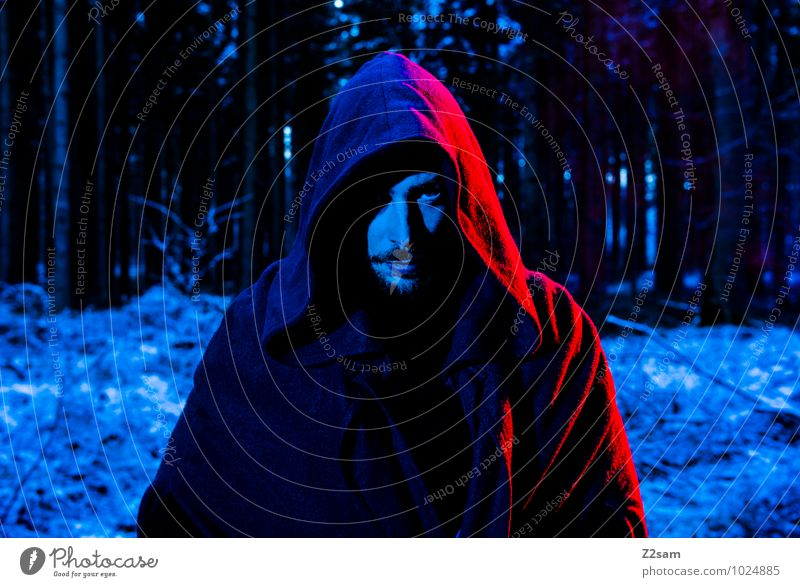 Dark Night Masculine Man Adults 30 - 45 years Nature Landscape Tree Bushes Forest Coat Hooded (clothing) Robe Facial hair Looking Cold Blue Red Anger Uniqueness