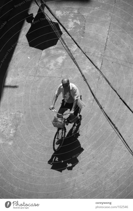 old man on bike Light Black & white photo Bicycle umbrella lines black and afternoon sun backlight shadow reminicent concrete almost riding alone company