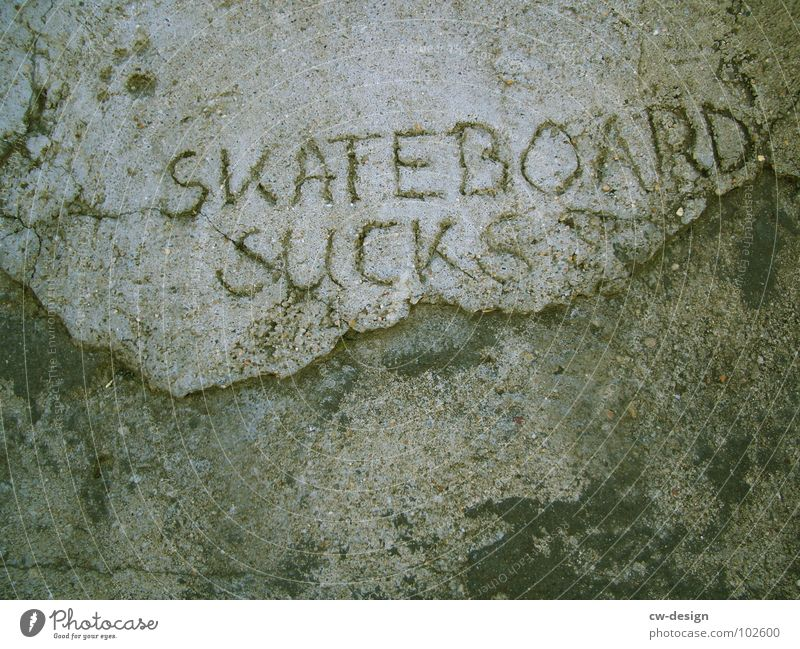 5K8B0ARD 5UCK5 S T O Skateboarding Concrete Dirty Characters Letters (alphabet) Word Symbols and metaphors Scribbles Trick Jump Wall (building) Gray Black Brown