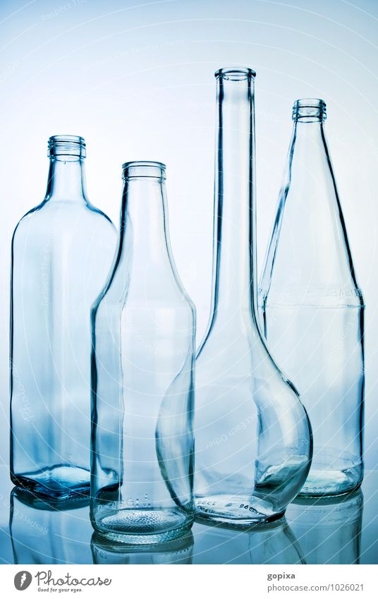 Empty glass bottles Bottle Glass Style Industry Trade Packaging Utilize Clean Blue Purity Esthetic Design Sustainability Pure Recycling Containers and vessels