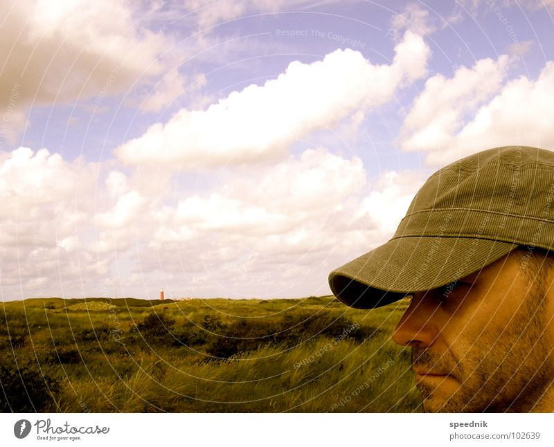 Man with cap [If I Think] Portrait photograph Multicoloured Pallid Yellow White Silhouette Facial hair Cap Baseball cap Clouds Hill Valley Coast Sea water