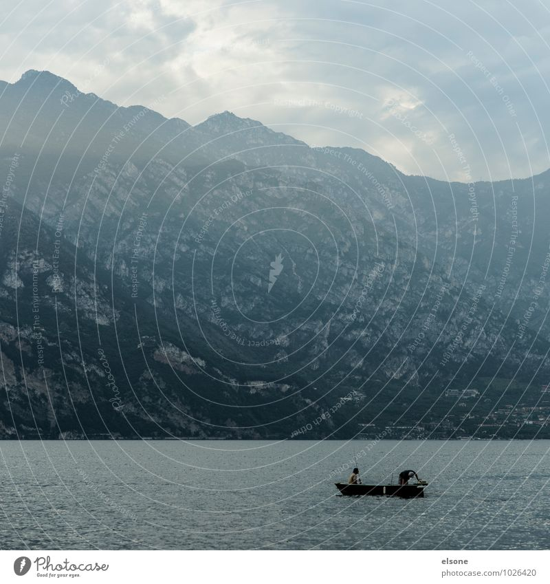 Human being Vacation & Travel Water Calm Mountain Lake Watercraft Rock Friendship Masculine Fog Tourism Italy Alps Fish Athletic
