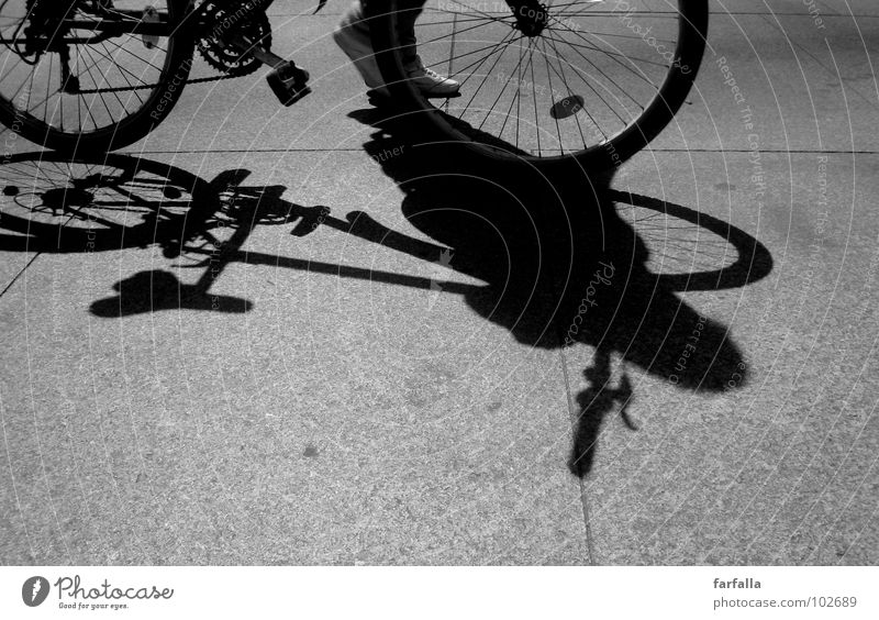 Bicycle... Bicycle... Light Dark Pedestrian Pedal Human being Black & white photo Shadow Street road Feet Wheel Cycling