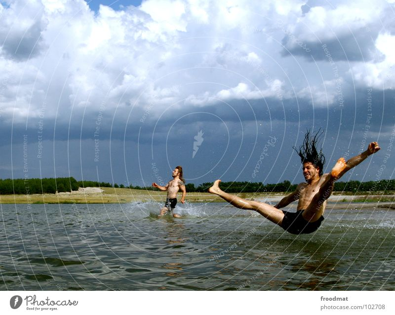 Youth (Young adults) Water Vacation & Travel Summer Joy Clouds Movement Jump Lake Germany Swimming & Bathing Flying Leisure and hobbies Wet Masculine Action