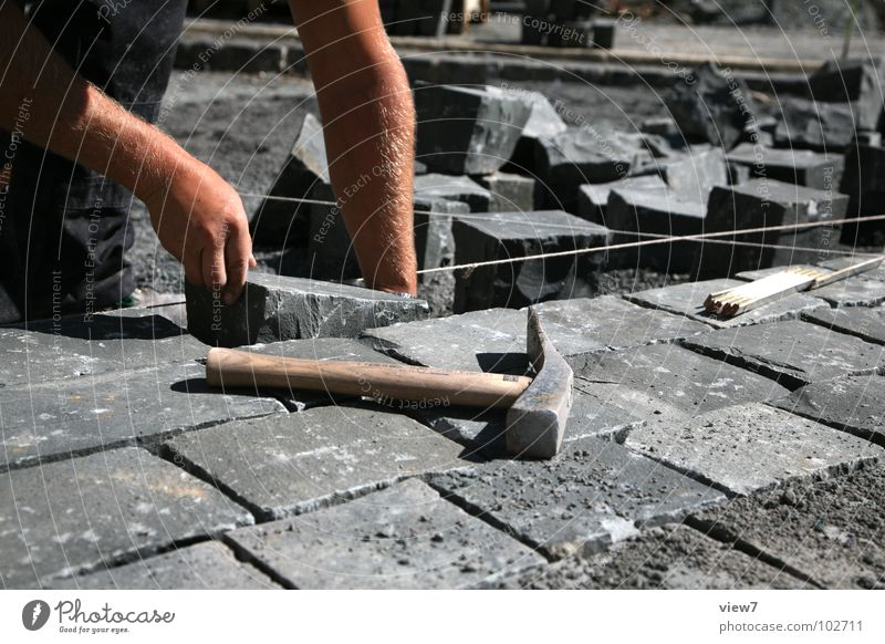 Man Hand Street Stone Lanes & trails Line Arm Masculine Floor covering Construction site String Craft (trade) Row Traffic infrastructure Cobblestones Construction worker