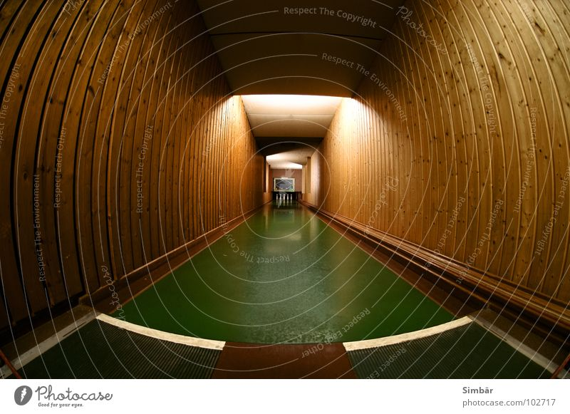 tunnel vision Wood Wall (building) Green Nine-pin bowling Bowling Club Society Sports Playing Railroad Floor covering Coil