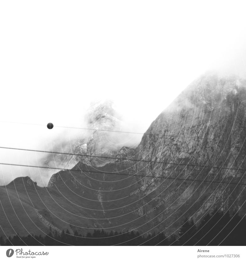 incipient visual disturbance Landscape Sky Clouds Fog Forest Rock Alps Mountain Peak vaud Switzerland Cable car Rope Wire cable Sphere Threat Dark Gray Black