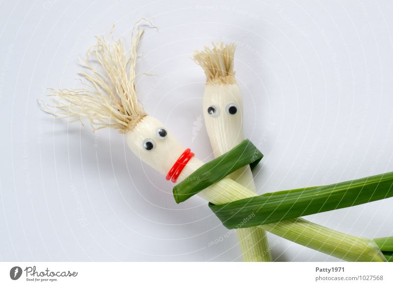 Shallots with glued on googly eyes represents a couple embracing each other Vegetable Onion To hold on Embrace Safety (feeling of) Together Colour photo Trust