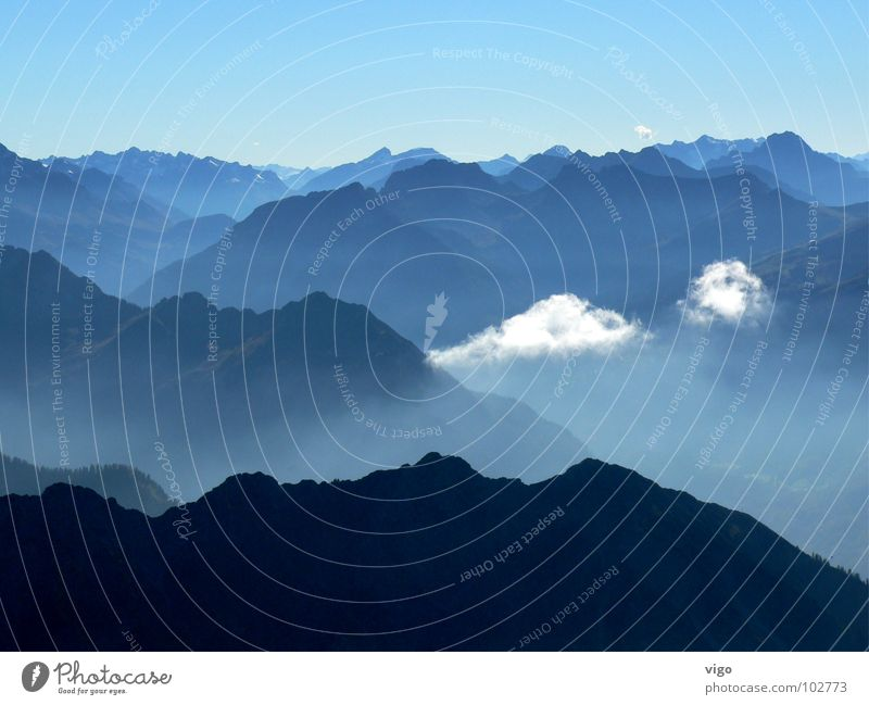 Behind the seven mountains ... Mountain range Clouds Blue Alps Sky