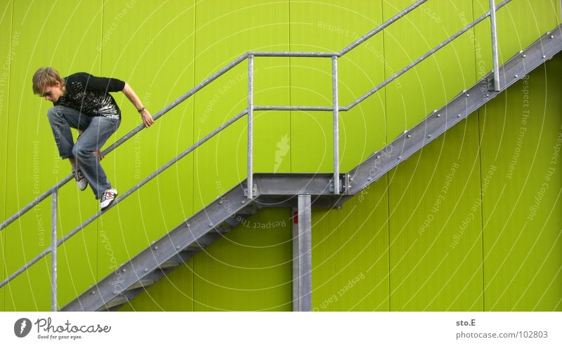 Human being Youth (Young adults) Green Wall (building) Jump Wall (barrier) Line Background picture Fear Arm Stairs Tall Arrangement Dangerous Crazy Perspective