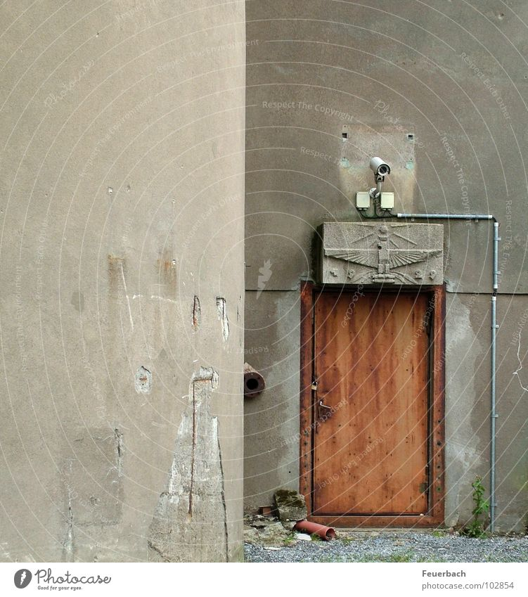 What needs to be secured... Colour photo Exterior shot Deserted Industry Video camera Factory Wall (barrier) Wall (building) Door Concrete Threat Gloomy Gray