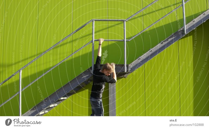 Human being Youth (Young adults) Green Wall (building) Wall (barrier) Line Background picture Fear Arm Stairs Tall Arrangement Dangerous Crazy Perspective