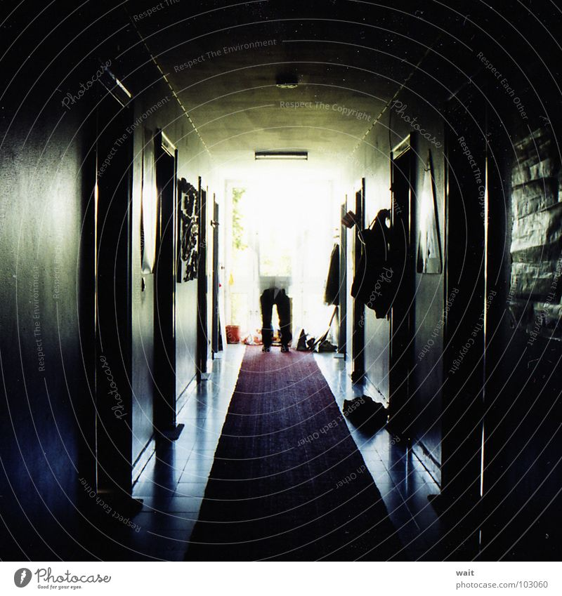 Legs in the hallway Hallway Dark Central perspective Vanishing point Red carpet Carpet Fear Panic Long exposure Light at the end of the tunnel