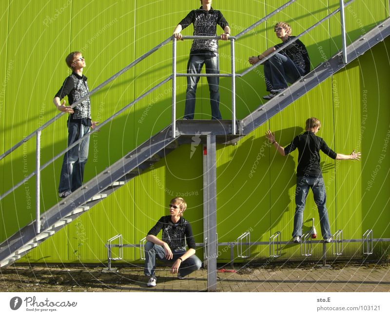 Human being Man Youth (Young adults) Green Wall (building) To talk Wall (barrier) Happy Stone Work and employment Fear Masculine Stairs Arm Sit Success