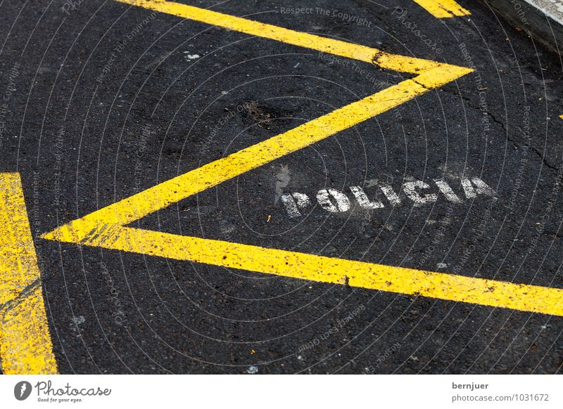 police Town Places Transport Street Car Line Yellow Black White Spanish Police Force Parking lot Asphalt reserved Room writing Zigzag policia Clearway Tar