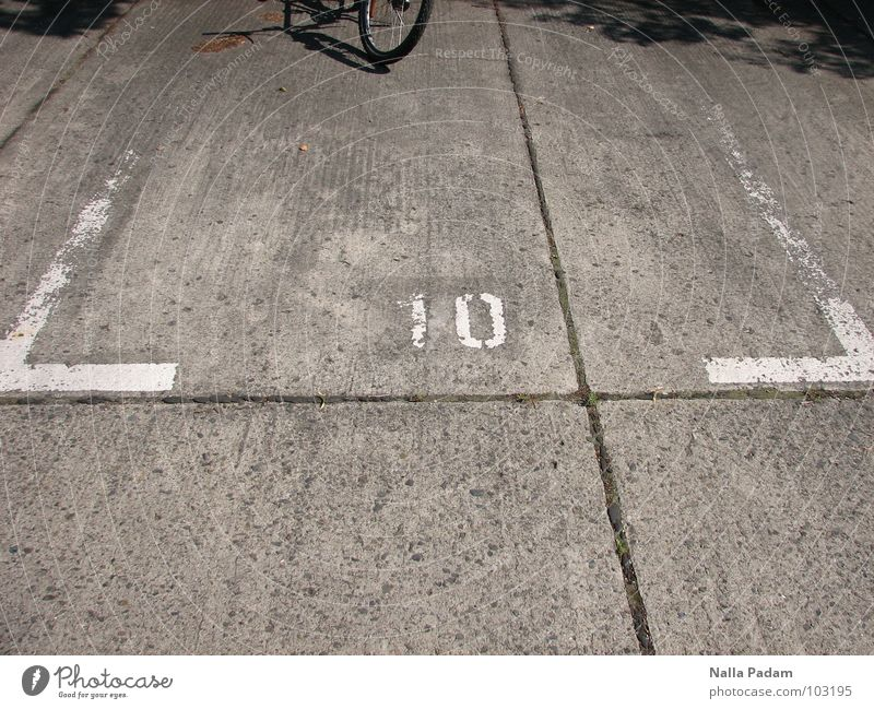 bicycle parking Bicycle Beautiful weather Traffic infrastructure Concrete Digits and numbers Free Gray Refrain Hope 10 parking space Colour photo Exterior shot