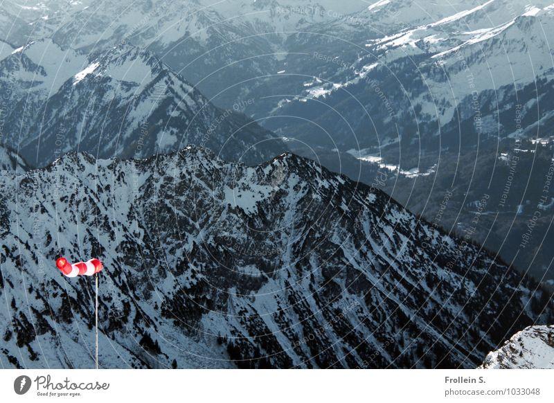 Jodeldö di Dödeldu Environment Nature Landscape Winter Wind Snow Alps Mountain Snowcapped peak Windsock Far-off places Red Black White Deep Colour photo
