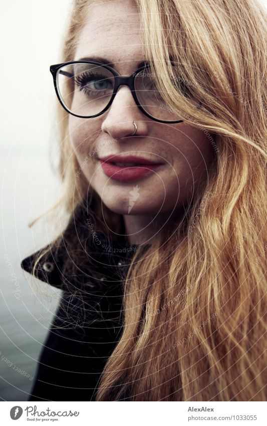 waves Trip Young woman Youth (Young adults) Face Freckles brood 18 - 30 years Adults Coat Eyeglasses Red-haired Long-haired Smiling Looking Esthetic Exceptional