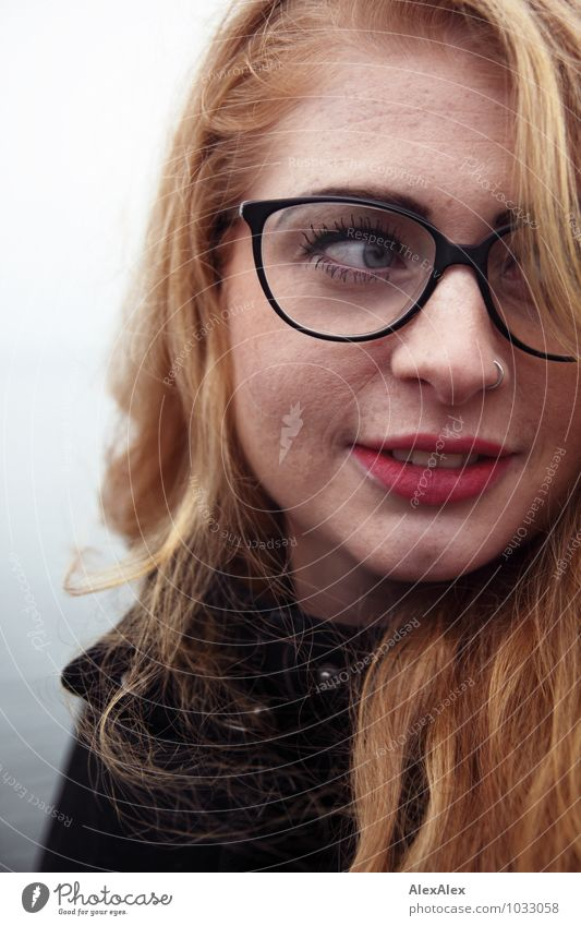 observantly Young woman Youth (Young adults) Face Freckles dimpled chin 18 - 30 years Adults Coast Coat Eyeglasses Red-haired Long-haired Watchfulness Observe