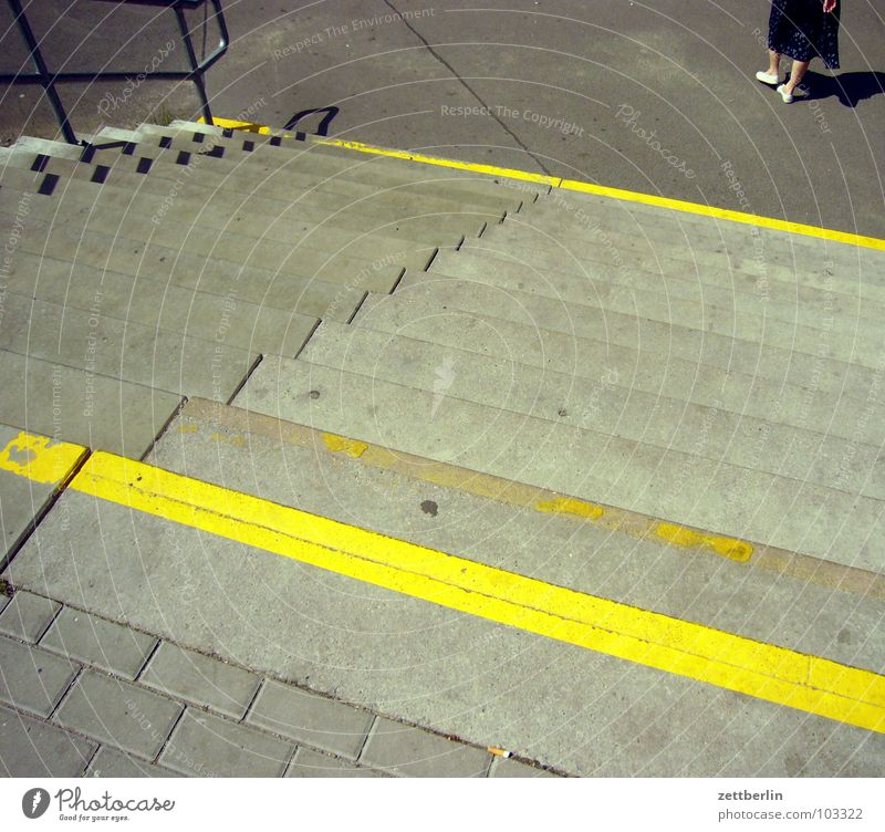 staircase Yellow Stripe Calf Downward Upward Go up Descent Ascending Level Story Access Bright yellow Seam Detail Woman Stairs Feet Difference Train station