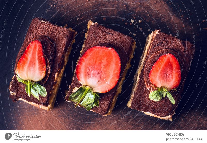 Chocolate Tiramisu cake with strawberries on black slate Food Dough Baked goods Cake Dessert Nutrition To have a coffee Organic produce Vegetarian diet Diet