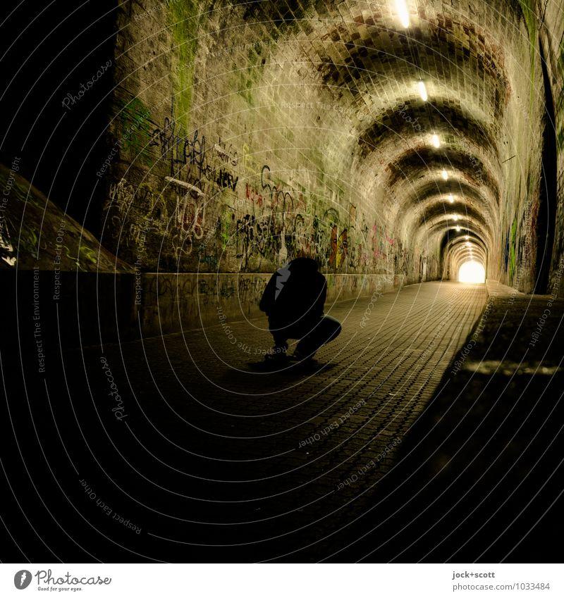 frog in a tunnel Masculine 1 Human being Saarbrücken Tunnel Vault Pedestrian Tunnel lighting Tunnel effect Crouch Illuminate Wait Dark Long Emotions Moody