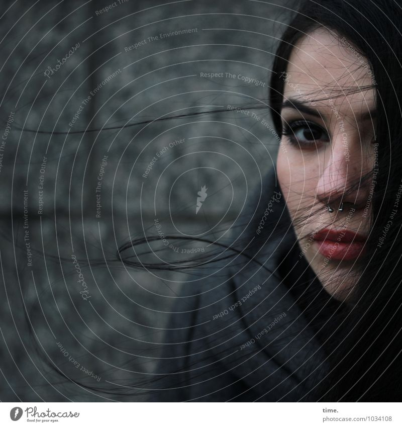 . Feminine Young woman Youth (Young adults) 1 Human being Wall (barrier) Wall (building) Coat Piercing Black-haired Long-haired Observe Think Looking Wait Dark
