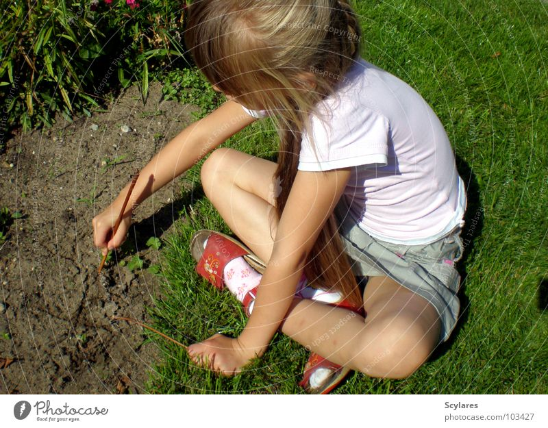 Deepened in creativity Girl Stick Child Summer Long-haired Blonde Write Sand Lawn Draw Twig Sit hollowed Creativity