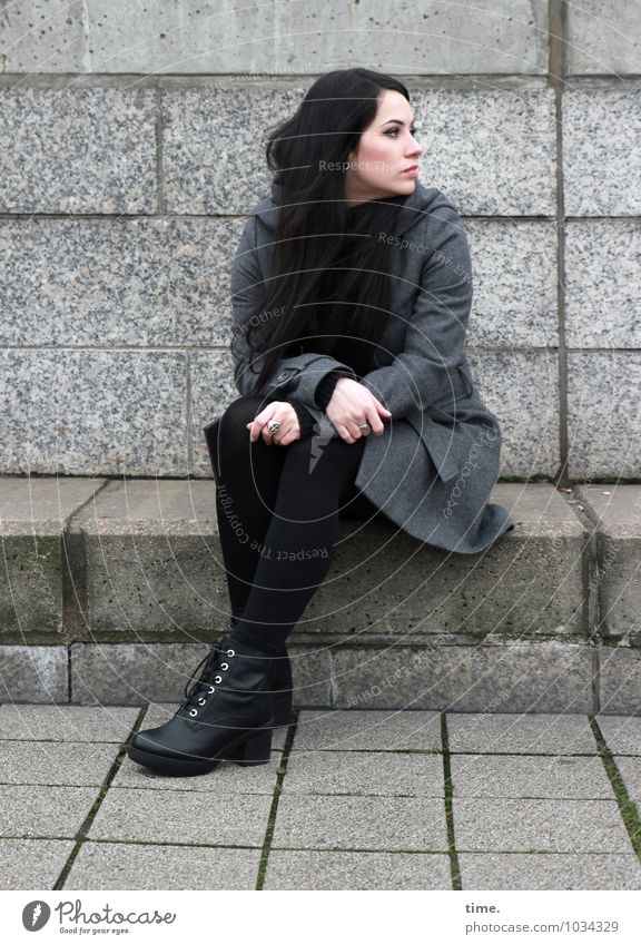 . Feminine Young woman Youth (Young adults) 1 Human being Wall (barrier) Wall (building) Coat Piercing Footwear Black-haired Long-haired Observe Think Looking