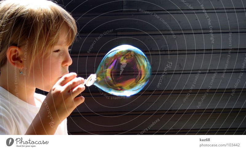 soap bubble Soap bubble Round Blow Rainbow Happiness Multicoloured Air Black Whim Background picture Wood Playing Action Caustic solution Girl Blonde