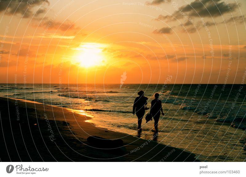 Human being Water Sun Ocean Beach Vacation & Travel Clouds Moody Waves Coast Horizon To go for a walk Dusk Caribbean Sea