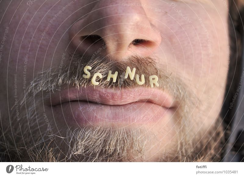 Man wears mustache Whisker Hair and hairstyles Letters (alphabet) Alphabet noodles spell Pelt Nose Characters Mouth Face Human being Facial hair Masculine Lips