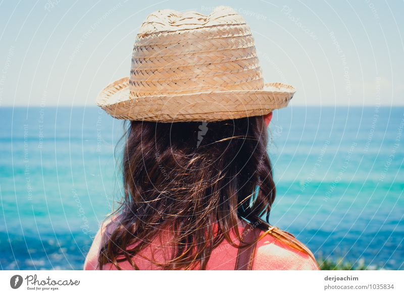 Excursion, Girl with sun hat on the beach of the blue ocean and looking at the sea Joy Relaxation Ocean Hiking Feminine Hair and hairstyles 1 Human being
